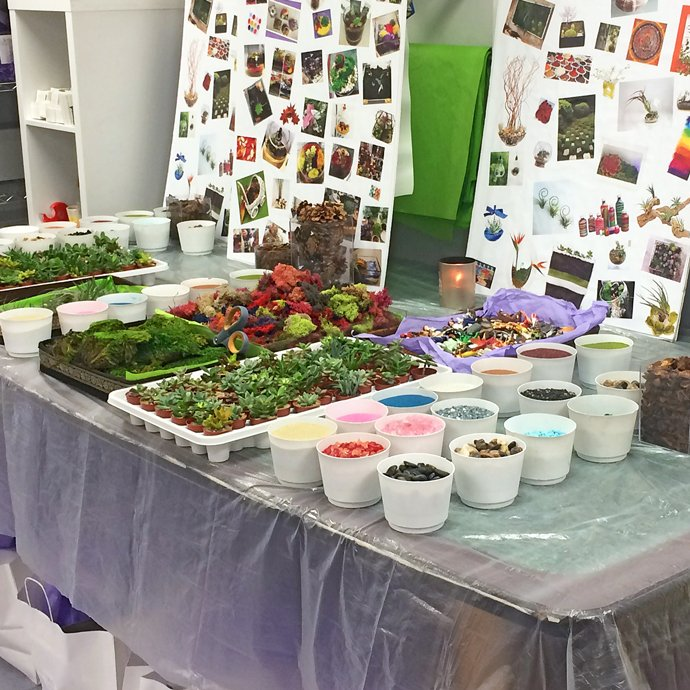 Terrarium class table setup with vision boards